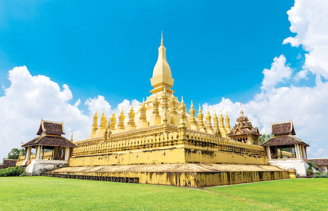Laos-travel-landmark,-golden-pagoda-wat-Phra-That-Luang-in-Vientiane.-Buddhist-temple