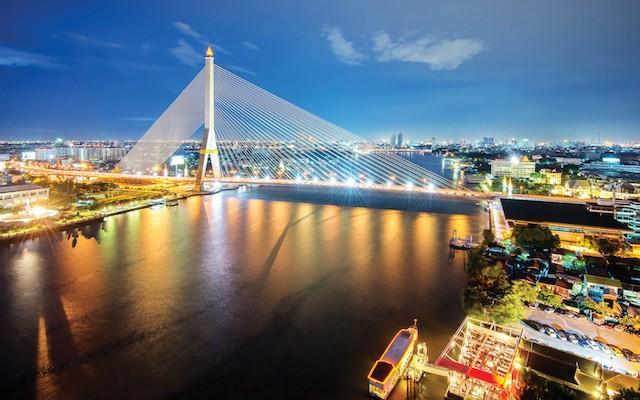 Rama-VIII-Bridge-at-night-in-Bangkok-and-Chopraya-river,-Thailand-copy
